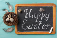 Phrase Happy Esther on chalkboard and nest with eggs Stock Photography