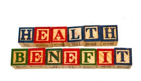 The phrase health benefit displayed visually on a white background. Using colorful wooden toy blocks image in landscape format Stock Photography