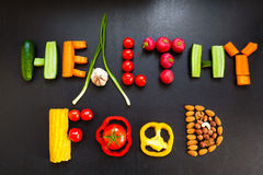 The phrase `Healthy food` is made from fresh vegetables and nuts. Stock Photo