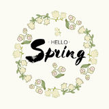 Phrase Hello spring Brush Pen lettering  on background. Handwritten  Illustration. Hand drawing wreath of stylized l Royalty Free Stock Photo