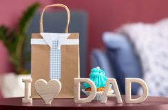 Phrase `I love dad` and gift bag on tabl. E. Father`s day celebration Royalty Free Stock Images