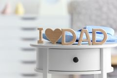 Phrase `I love dad` on table. Father`s day celebration Stock Image