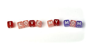 Phrase I love my mom. On multicolored wooden cubes white isolated Royalty Free Stock Photo