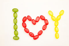 Phrase I love you made of sugar candy. On white Stock Photo