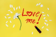 The phrase: love me , written by lipstick Royalty Free Stock Photos