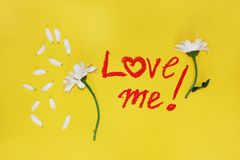 The phrase: love me , written by lipstick Stock Image