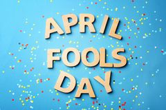 Phrase. `April fools day` and confetti on color background Stock Image