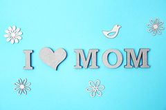Phrase. `I LOVE MOM` made of letters on color background. Happy Mother`s Day Royalty Free Stock Photos