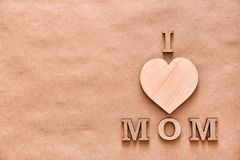 Phrase. `I LOVE MOM` made of letters on paper background. Happy Mother`s Day Royalty Free Stock Photo
