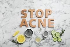 Phrase. `Stop acne` and homemade effective problem skin remedies on light background, flat lay Stock Photos