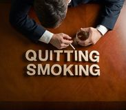 Phrase Quitting Smoking and devastated man Royalty Free Stock Photo