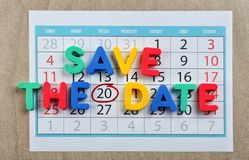 Phrase SAVE THE DATE composed with colorful letters on calendar stock photo