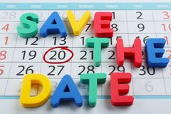 Phrase SAVE THE DATE composed with colorful letters on calendar stock photography