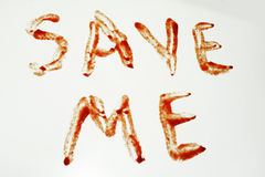 Phrase Save Me. Written with blood on white background Royalty Free Stock Image