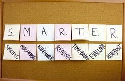 A yellow sticky note writing, caption, inscription Phrase SMARTER in black ext on a sticky note pinned to a cork notice. Phrase SMARTER in black ext on a sticky stock images