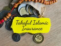 Free Phrase TAKAFUL ISLAMIC INSURANCE Written On Strip Paper With Sack Of Coins And Prayer Beads. Royalty Free Stock Image - 215438796
