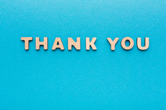 Phrase Thank You on blue background. Politeness, thanks, gratitude concept Royalty Free Stock Photo