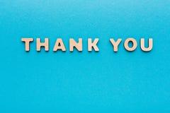 Phrase Thank You on blue background Royalty Free Stock Photo