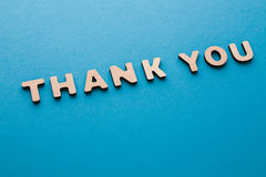 Phrase Thank You on blue background. Politeness, thanks, gratitude concept Royalty Free Stock Image