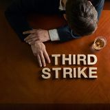 Phrase Third Strike and devastated man composition Royalty Free Stock Photos