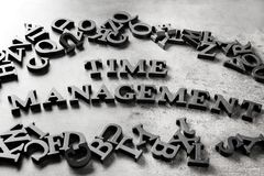 Phrase TIME MANAGEMENT composed from letters on gray background royalty free stock photos