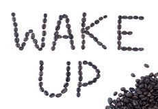 Wake Up - Coffee Beans. The phrase Wake Up written with coffee beans Stock Image