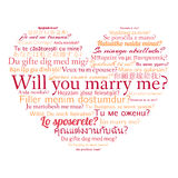Phrase will you marry me in different languages. Words in cloud in the shape of heart Royalty Free Stock Images