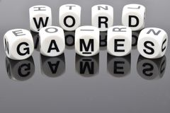 WORD GAMES in dice. The phrase WORD GAMES spelt out in letter dice Royalty Free Stock Photo