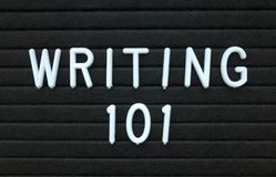 The phrase Writing 101 in white text on a letter board Royalty Free Stock Image