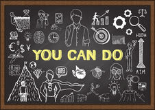 The phrase YOU CAN DO with business doodles on chalkboard. Stock Photography