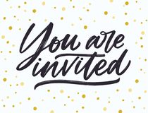 Phrase You Are Invited handwritten with elegant cursive calligraphic font and brush stroke on dotted background. Beautiful written lettering or inscription Royalty Free Stock Photo