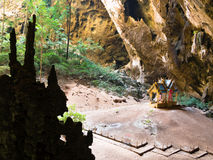 Phraya Nakhon cave at National Park Khao Sam Roi Yot with ancient temples and tall trees in the background Stock Image