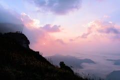 Phu Chi Fah in Chiang Rai, Thailand at sunrise. Stock Photos