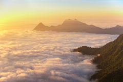 Phu chi fah. A sunrise over the fog in phu chi fah mountain ,chiang rai , Thailand Royalty Free Stock Images