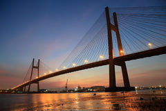 Phu My wire bridge at Saigon ( Ho Chi Minh City ) , Vietnam in the sunset. Royalty Free Stock Photo