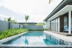 PHU QUOC, VIETNAM JUNE 28, 2017: Tropical beach resort. Swimming pool near living room.  stock image
