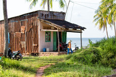 PHU QUOC, VIETNAM - OCTOBER 25, 2014: Coast of one of the islands of Phu Quoc island - sea, palms and bungalow. Stock Image