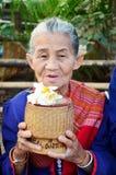 Phu tai people preparing food and almsgiving with sticky rice Royalty Free Stock Photo
