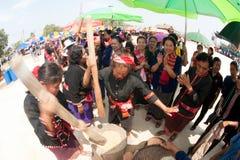 Phu Thai minority woman pounding rice. KALASIN,THAILAND-MARCH 9 : Unidentified  Phutai minority senior woman competitive pounding rice fun and happiness in The Stock Photography
