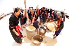 Phu Thai minority woman pounding and winnowing rice. Royalty Free Stock Image