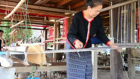 Phu Thai people using Loom or weaving machine stock video