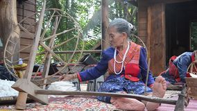 Phu Thai people using spinning cotton thread machine stock video