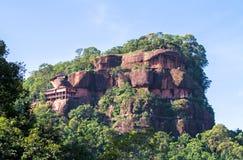 Phu tok mountain or Wat Jetiyakiree Viharn Temple with wooden tr Stock Photos