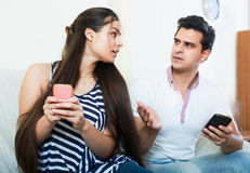 Phubbing: spouse asking for attention Royalty Free Stock Photography