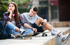 Phubbing: teenager ignore her friend. Phubbing: portrait of teenager and friend asking for attention Royalty Free Stock Images