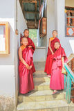 Phuentsholing, Bhutan - September 16, 2016: Young Bhutanese monks standing on the stairs of a monastery at Phuentsholing Town stock image