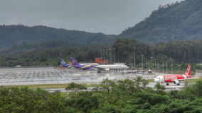 Phuket airport traffic at rain stock video footage