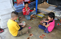 Phuket City, Thailand: Children Playing Cards Royalty Free Stock Photos