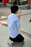 Phuket City, Thailand:  Young Man Praying Royalty Free Stock Photos