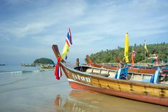 Wooden boats stand in the morning on the beach. PHUKET ISLAND, THAILAND - JANUARY: Phuket Island - the most expensive resort in Thailand Royalty Free Stock Images